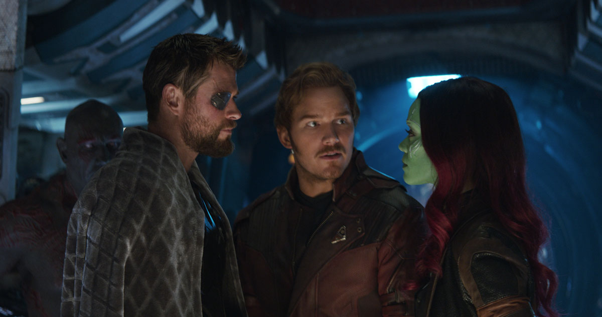 Thor (Chris Hemsworth) talks with Star-Lord/Peter Quill (Chris Pratt) and Gamora (Zoe Saldana) how to save the Infinity Stones in Marvel Studios' AVENGERS: INFINITY WAR