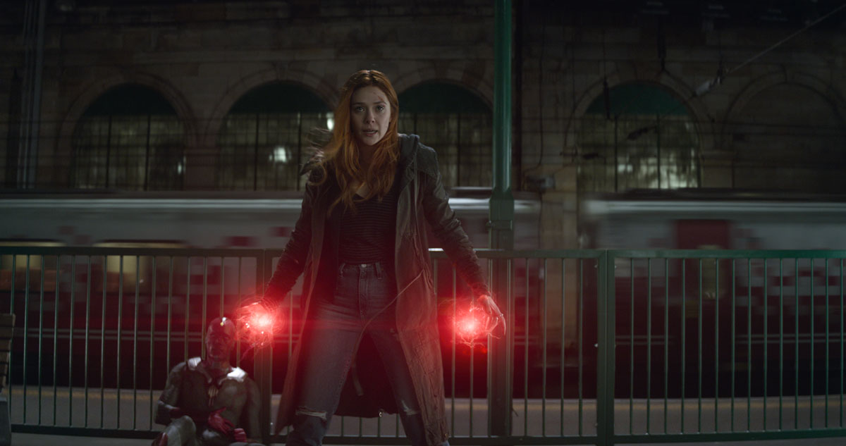 Scarlett Witch / Wanda Maximoff (Elisabeth Olsen) protects Vision (Paul Bettany) in Marvel Studios' AVENGERS: INFINITY WAR
