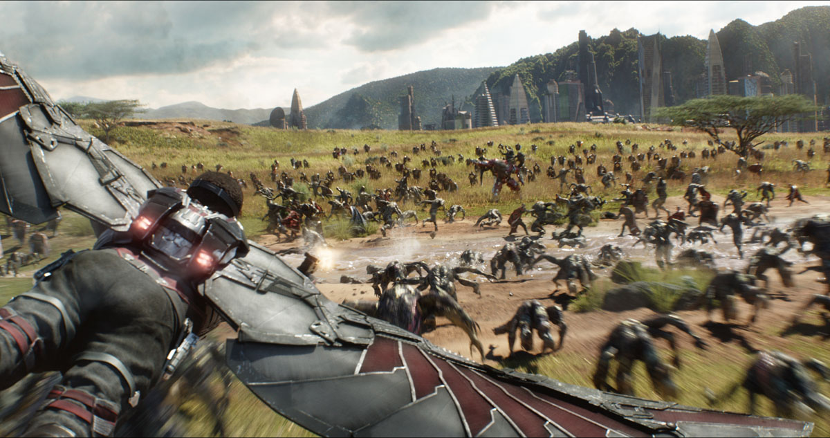 Falcon (Anthony Mackie) flying over Wakanda battlefield in Marvel Studios' AVENGERS: INFINITY WAR