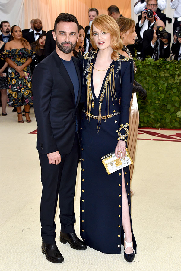 Nicolas Ghesquiere and Emma Stone attend the Heavenly Bodies: Fashion & The Catholic Imagination Costume Institute Met Gala at The Metropolitan Museum of Art on May 7, 2018 in New York City. (Photo by John Shearer/Getty Images for The Hollywood Reporter)