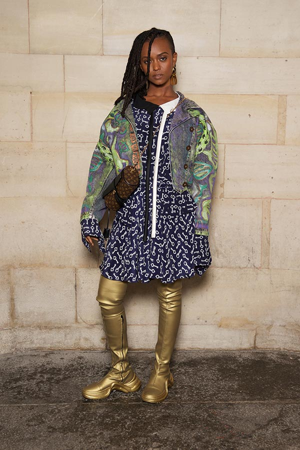 Kelela with a Louis Vuitton Clutch