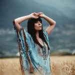 VALEUR Model Nina in a blue top in a wheat field