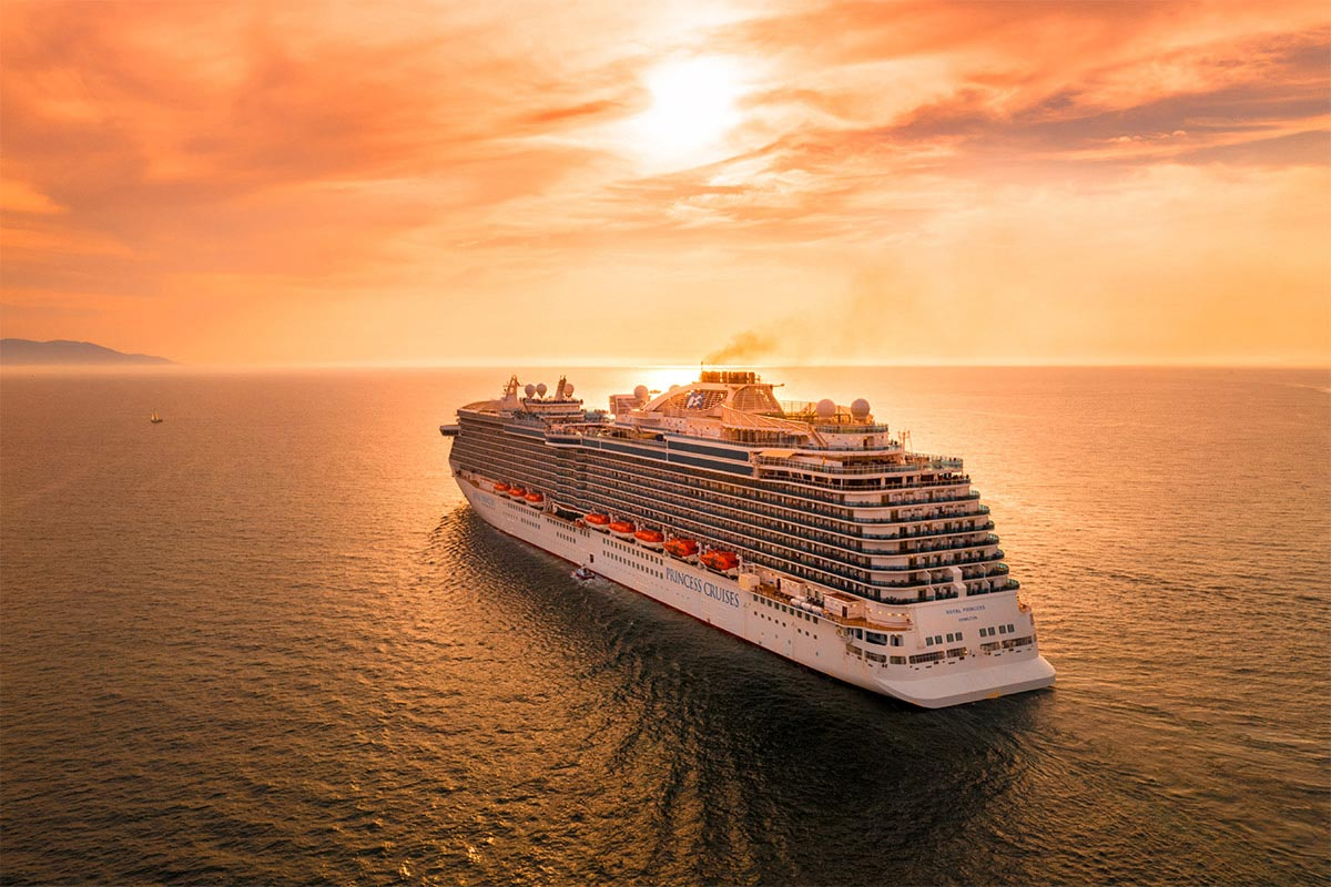 cruise ship at a beauitul sunset