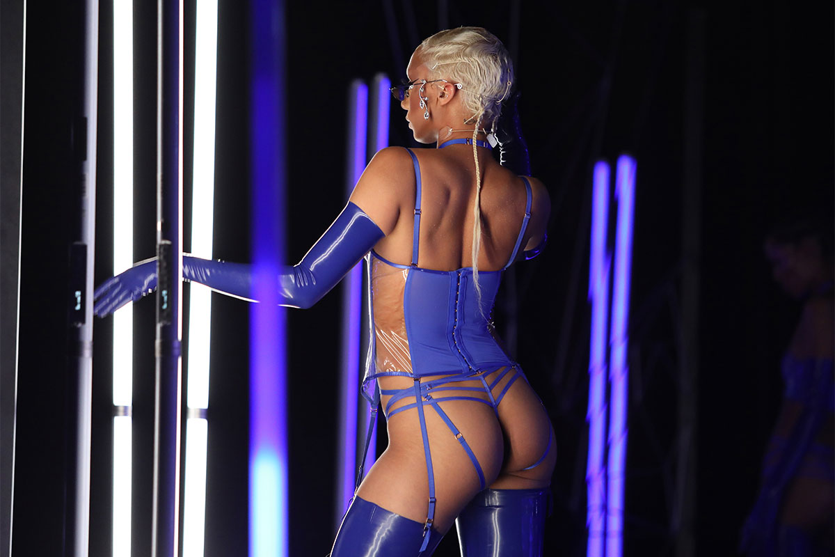 Jazzelle Zanaughtti shows her back in hot blue lingerie ©Jerritt Clark/Getty Images