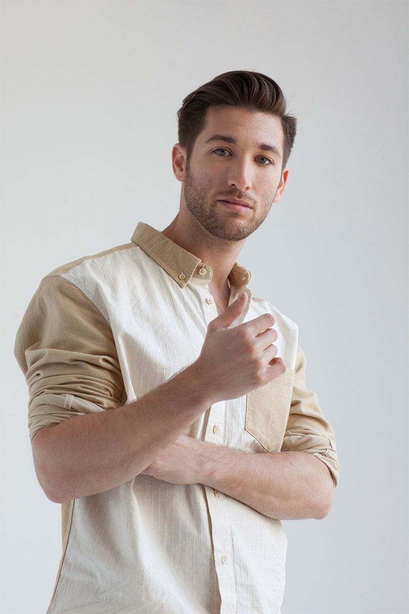 Justin Jesso in front of a white background in a white and light brown shirt